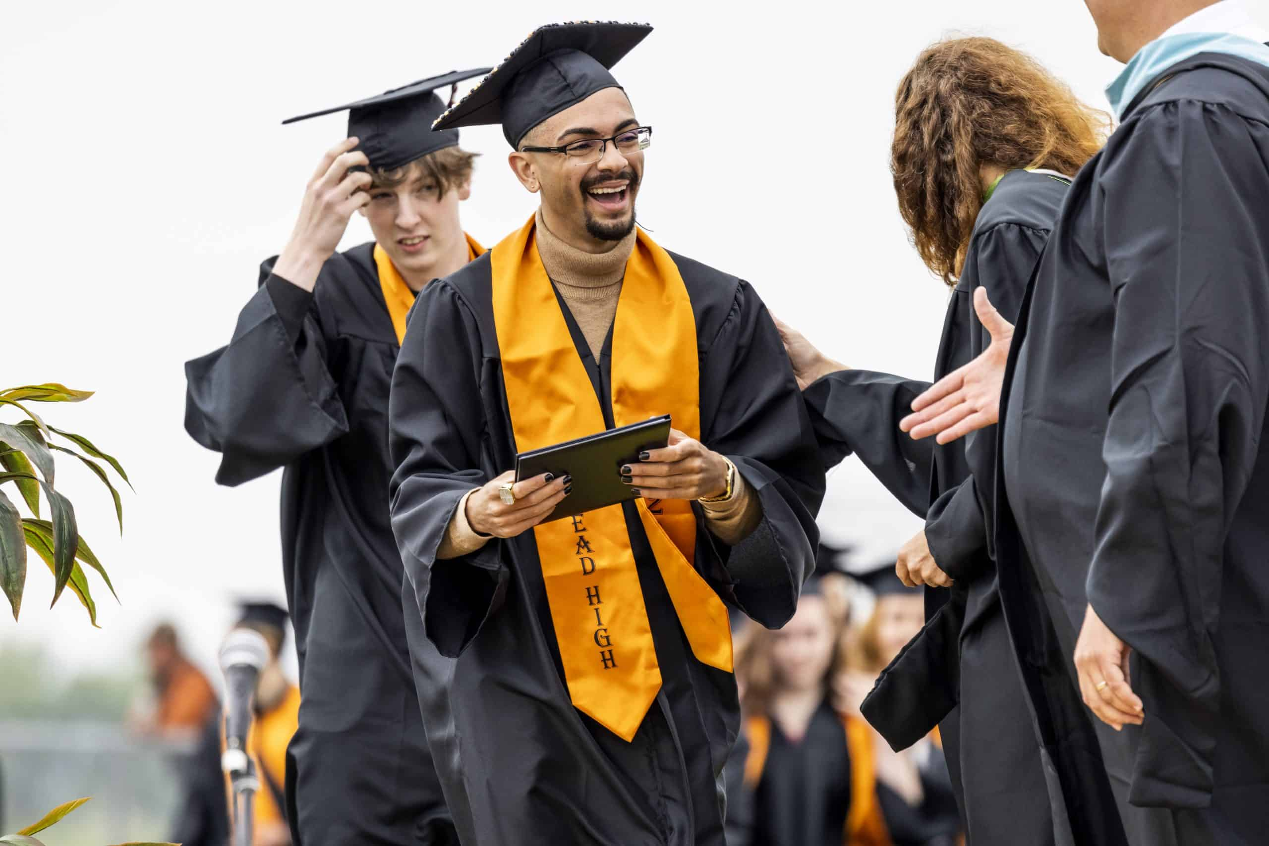Male graduate receiving his diploma